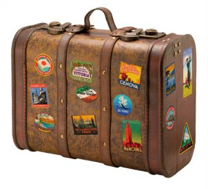 Brown suitcase with straps and sticks on it